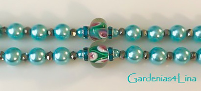 Detail of lampwork beads in Limited edition turquoise pearl and lampwork  rosary symbolizing Virgin  Mary's title, Seat of Wisdom